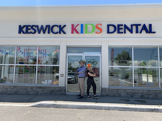Dr. Noah in front of Keswick Kids Dental Clinic